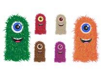 Famiglia simile a pelliccia del mostro nei colori differenti Immagine Stock Libera da Diritti