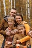 Famiglia sorridente felice Fotografia Stock