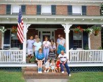 Famiglia sul portico Fotografie Stock
