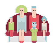 Famiglia sul sofà Fotografie Stock