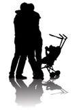Famiglie con le carrozzine Immagini Stock Libere da Diritti