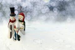 Famiglie del pupazzo di neve di Natale felice immagini stock