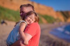 Famile on a beach Stock Photography