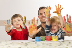 Famili is painting with finger paint Stock Photos