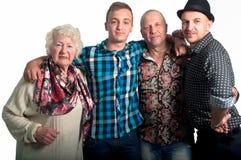 Familia - abuela, su hijo y nietos Imagen de archivo libre de regalías