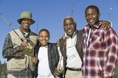 Familia africana con las cañas de pescar imagen de archivo libre de regalías