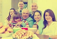Familia alegre de tres generaciones Imágenes de archivo libres de regalías