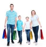 Familia americana feliz con los niños que sostienen los panieres Imagen de archivo