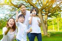 Familia asiática encantadora Foto de archivo libre de regalías