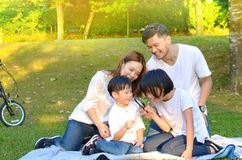 Familia asiática encantadora Imagen de archivo libre de regalías