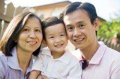 Familia asiática feliz Imagen de archivo libre de regalías