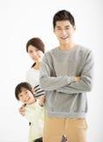 Familia asiática feliz que se une Foto de archivo