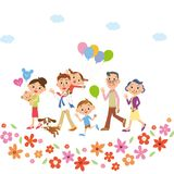 Familia a caminar en flores Imagen de archivo