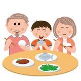 Familia, comiendo Fotos de archivo