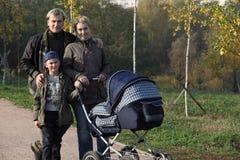 Familia con 2 cabritos Imágenes de archivo libres de regalías