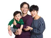 Familia con el hijo del padre, de la madre y del bebé Fotos de archivo libres de regalías