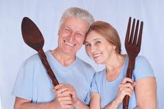 Familia con la cuchara y la fork Fotografía de archivo
