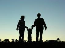 Familia con la silueta del bebé Fotografía de archivo