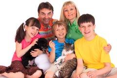 Familia con los animales domésticos Imágenes de archivo libres de regalías