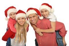 Familia con los niños en los sombreros de santa Fotos de archivo