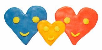 Familia de corazones sonrientes Fotografía de archivo libre de regalías