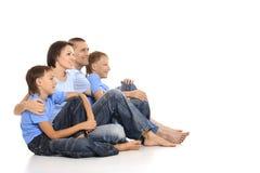 Familia de cuatro miembros feliz Imagenes de archivo