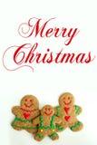 Familia de la galleta del pan de jengibre de la Navidad aislada en el fondo blanco Fotografía de archivo libre de regalías