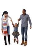Familia de la raza mixta con recorrer lindo de la niña Imagen de archivo libre de regalías