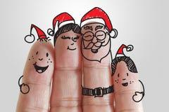 Familia de los dedos en la estación de la Navidad Imagen de archivo libre de regalías