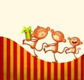 Familia de monos con un prezent Fotos de archivo libres de regalías
