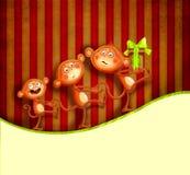 Familia de monos con un prezent Fotografía de archivo libre de regalías
