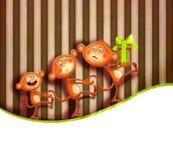 Familia de monos con un prezent Foto de archivo