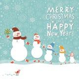 Familia de muñecos de nieve Imagen de archivo libre de regalías
