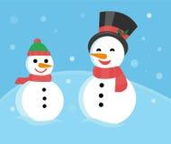 cd69face77c1a Familia de muñecos de nieve - muñecos de nieve del padre y del hijo en  casquillos