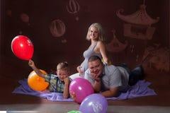 Familia de mujer del embarazo Imagenes de archivo