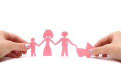 Familia de papel en manos Imagen de archivo