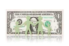 Familia de papel y un billete de banco del dólar Fotos de archivo libres de regalías