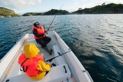 Familia de pesca Foto de archivo libre de regalías
