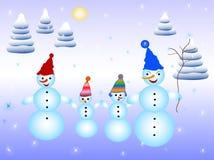 Familia de Snowmens Foto de archivo libre de regalías