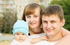 Familia de tres Imagen de archivo