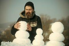 Familia del muñeco de nieve hecha de la nieve blanca Fotos de archivo