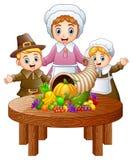 Familia del peregrino con la cornucopia de frutas y verduras en la tabla de madera redonda ilustración del vector
