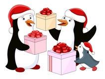 Familia del pingüino con los regalos ilustración del vector