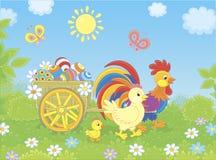Familia del pollo con un carro de los huevos de Pascua