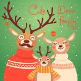 Familia del reno de la Navidad La tarjeta linda con los ciervos es Foto de archivo libre de regalías