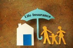 Familia del seguro de vida Imagenes de archivo