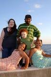 Familia diversa feliz en el océano Fotografía de archivo libre de regalías