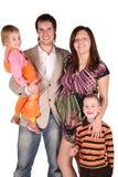 Familia embarazada con los niños Fotos de archivo libres de regalías