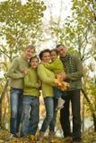 Familia en bosque del otoño Imagen de archivo libre de regalías