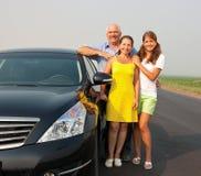 Familia en coche Foto de archivo libre de regalías